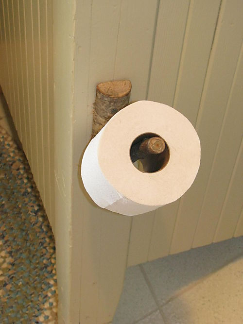 Tree branch toilet tissue holder